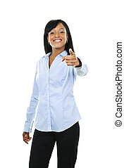 Smiling young woman pointing finger forward - Smiling black...