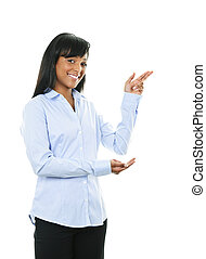 Smiling young woman pointing - Smiling black woman pointing...