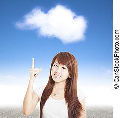 smiling young woman pointing to the cloud