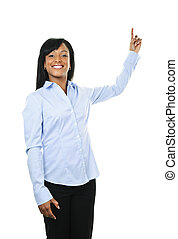 Smiling young woman pointing up