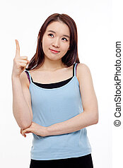 Smiling young woman pointing upwards