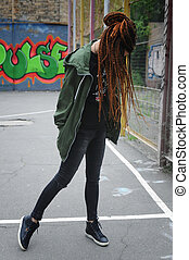 Smiling young woman portrait with dreadlocks