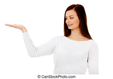 Smiling young woman presenting something on open palm