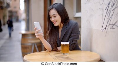 Smiling young woman relaxing with a beer