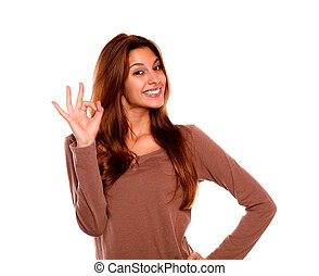 Smiling young woman saying great job with her hand - ...