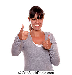 Smiling young woman showing you ok sign