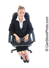 Smiling young woman sitting on an office chair