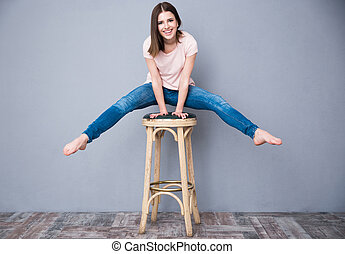 Smiling young woman sitting on the chair