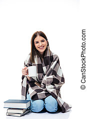 Smiling young woman sitting with cup of coffee - Smiling ...