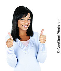 Smiling young woman - Smiling black woman giving thumbs up...