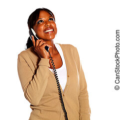 Smiling young woman speaking on phone