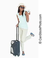 Smiling young woman traveling