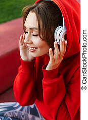 Smiling young woman wearing hoodie
