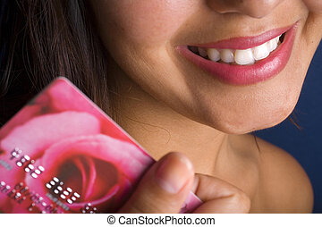 smiling young woman with a credit card