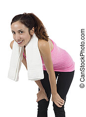 Smiling young woman with a towel after workout