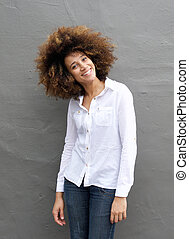 Smiling young woman with afro hairstyle