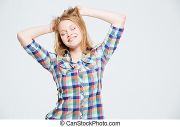 Smiling young woman with closed eyes