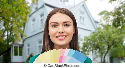 smiling young woman with color swatches