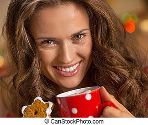 smiling young woman with cup of hot chocolate and ch