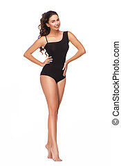 Smiling young woman with curly hair in black swimsuit