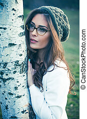 young woman with eyeglasses outdoor portrait
