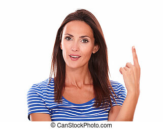 Smiling young woman with finger pointing up