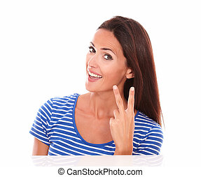 Smiling young woman with fingers up
