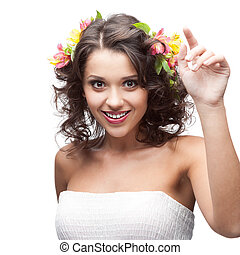 smiling young woman with flower in hair