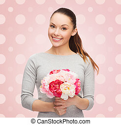 smiling young woman with flower