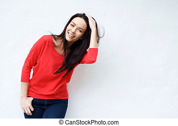 Smiling young woman with hand in hair