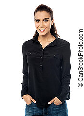 Smiling young woman with hand in pocket