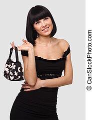 Smiling young woman with handbag