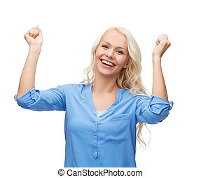 smiling young woman with hands up