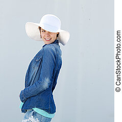 Smiling young woman with hat