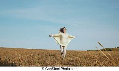 Smiling young woman with outstretched hands feels freedom. -...