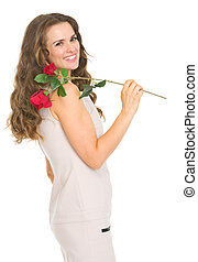 Smiling young woman with red rose