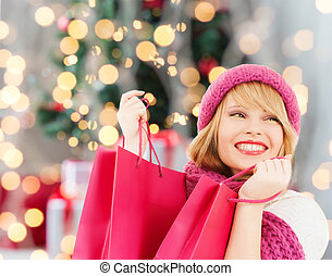 smiling young woman with shopping bags - happiness, winter ...