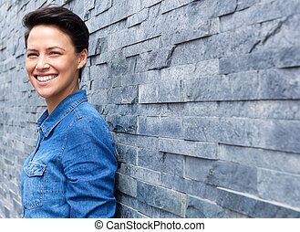 Smiling young woman with short hair