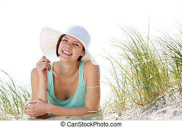Smiling young woman with sun hat