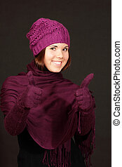 smiling young woman with thumbs up, isolated