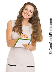 Smiling young woman writing in notepad