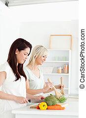 Smiling young Women preparing dinner