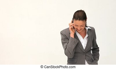 Smilling and pretty businesswoman phoning against a white...