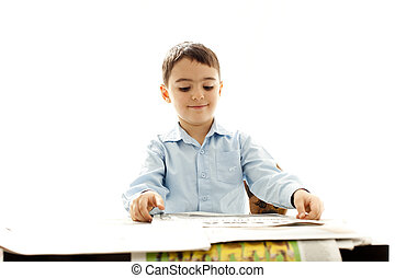 smilling boy with newspaper