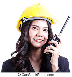 Smilling female construction worker talking with a walkie talkie and orders to stop.