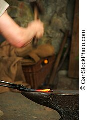 Smith at work - Smith\\\'s hammer is forming the glowing...