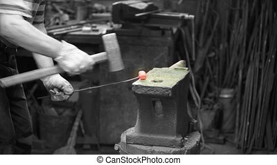 smith forging red iron
