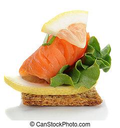 Smocked Salmon - Close-up of smoked salmon served with...