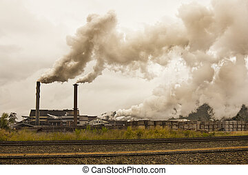 smog and pollution coming from a sugar mill