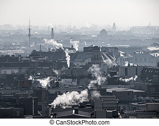 Smog - city air pollution. Unclear atmosphere polluted by smoke rising from the chimneys.